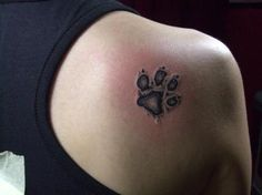 I want to get my boxer  paw print on my foot. Want it to kind of look like this, but I want the pink and black coloring that he has on his paw as well.....tattoo to remember Bailey??  Or taking it too far?