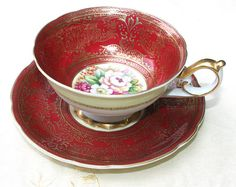Antique cup and saucer. Hand painted in by AnythingDiscovered
