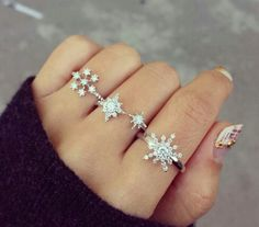 Love the idea of a different snowflake crystal (or diamond...) ring for each finger! Especially now that I live where it doesn't snow for Christmas : (