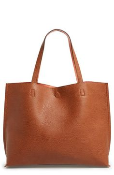 Free shipping and returns on Street Level Reversible Faux Leather Tote & Wristlet at Nordstrom.com. Colored faux leather flips inside-out for a reversible tote with unlimited styling options. A matching wristlet furthers the versatility and completes the look.