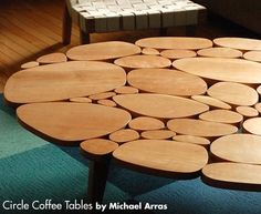 I chose this picture because of the shapes. They create a jigsaw puzzle type table that doesn't actually fit together. The shapes give the table a very organic feel. #furniture