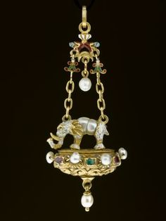 (Italy) Pendant jewel of gold, enamelled and set with rubies, emeralds and pearls, an elephant on a platform with scroll work. probably Italian, ca century CE. Enamel Jewelry, Pearl Jewelry, Jewelry Art, Antique Jewelry, Gold Jewelry, Vintage Jewelry, Fine Jewelry, Jewelry Design, Renaissance Jewelry