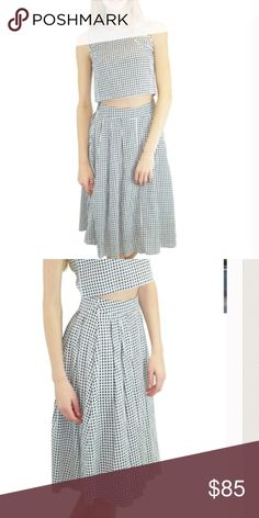 ✨HP✨ Gingham Crop Top & Midi Skirt Set Stunning black and white gingham crop top and midi skirt set from boutique designer Relished. These pieces make a stellar statement together but can extend your wardrobe worn with a great pair of high rise jeans or a crisp white shirt.  Sizes small through large available.  100% Cotton. Lining is poly. Runs slightly small. Relished Skirts Skirt Sets
