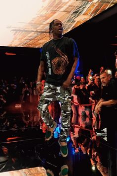 Travis Scott wearing  Vintage 1995 Nine Inch Nails Further Down The Spiral  T-Shirt, Nike Marc Newson Air Vapormax, Vetements Camo Trousers