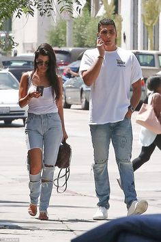Anything you can do: Kourtney Kardashian, 38, is certainly giving her playboy former partner Scott Disick a run for his money in the younger lover stakes after she was spotted out with hunky model Younes Bendjima, 23