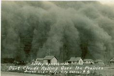 """A haboobish dust cloud engulfs a Kansas outpost in 1935. The dust was presumably part of a gigantic dirt storm that killed birds while they flew. Said the National Weather Service: """"The onrushing cloud, the darkness, and the thick, choking dirt, made this storm one of terror and the worst, while it lasted, ever known here."""""""