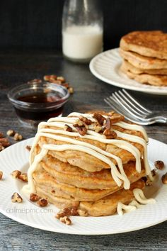Whole Wheat Banana Pancakes recipe covered in a cream cheese 'syrup'
