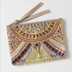 """Anthropologie KALEIDOSCOPE LENS BEADED CLUTCH-NEW Anthropologie KALEIDOSCOPE LENS BEADED CLUTCH RETAIL $148 MPN 25686544 COLOR: Gold By Jasper & Jeera Zip top Cotton, leather;  cotton lining 7.5""""H, 10.5""""W, 0.5""""D Imported - BRAND NEW - SOLD OUT Anthropologie Bags"""