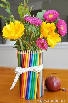 Surround an ordinary glass or jar with color pencils for a colorful and creative vase centerpiece for a children's party, especially if it is an art party.  For ideas and goods shop at Estate ReSale & ReDesign, LLC in Bonita Springs, FL