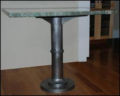 Steel Table Base With A Clear Coated Sandblasted Satin Finish And A Granite  Table Top.