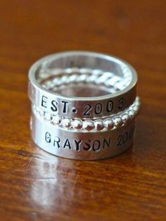 Name Stacking Rings – Thin Thick Bead Bands Personalize a stackable mothers ring hand stamped with names of children, wedding date and meaningful words- unique design allows moms in large families to honor all her children.    Sterling silver- hand stamped- stacking ring set – three rings.  4mm band is personalized with up to 11 characters.  6mm band accommodates up to 30 characters (including spaces and accent stamps).