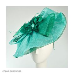Stand out with this beautiful turquoise Giovannio by Emma B Large Bow Fascinator! Perfect for the races or a cocktail party, this fascinator will be the talk of the town.