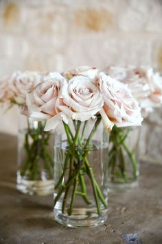 simple blush pink roses for centerpieces. So romantic!