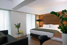Superior Room with double bed equipped with premium COCO-MAT Eco bed systems with feather toppers Superior Room, Hardwood Floors, Flooring, Double Beds, Contemporary Style, Rooms, Feather, Furniture, Home Decor