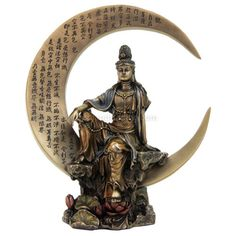 """A beautiful depiction of the Asian Mother of Mercy in bronze finish and seated on a crescent moon. Stands approximately 8"""" tall. In Eastern mythology, she is associated with compassion and pure love."""