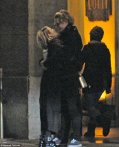 Embrace: Emma Roberts and Evan Peters looked every inch the loved up couple while sharing a passionate kiss and loving embrace in the city