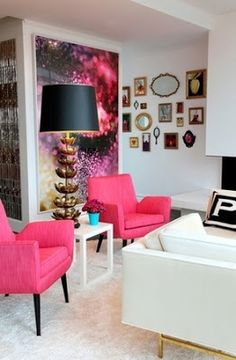 Pink chairs, gotta' be a girls appartment. Love the large artwork on those two walls as well!