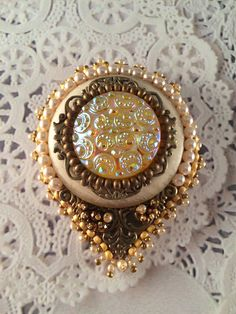 Coat pin; Czech button on filigree with creamrose pearls.