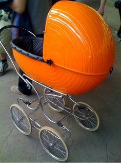 first thought: CADBURY EGG! (because of the concentric ovals, not because of the color). Sweet stroller, too.