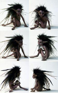 (Cute! -I like the feather hair) Wild faun fantasy earth fairy sculpture