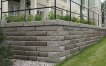 SienaStone® Retaining Wall- ienaStone® combines the stability of large modular units with a popular natural rock-like appearance. It's proportions are well suited for both residential and commercial applications. SienaStone's long lines and split face make it an attractive alternative for most heavy load bearing applications.