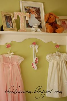 """The craft in this pic is the """"T"""" with the pretty paper glued to it, but I love the baby shoe with the white ribbon hot glued to it. What an adorable way to display those baby shoes. Hot glue gun, here I come!"""