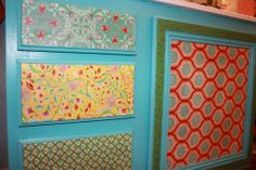 Mod Podge fabric on wood cabinets
