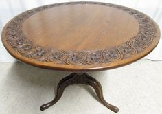 Carved Oak Tilt Top Round Table