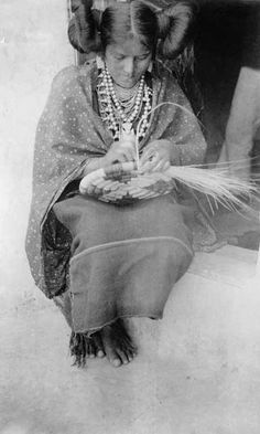 Portrait of unidentified Native American woman (Hopi) weaving a basket - Matteson - 1899