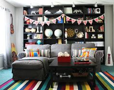 Great rug and use of color throughout this otherwise masculine game room!