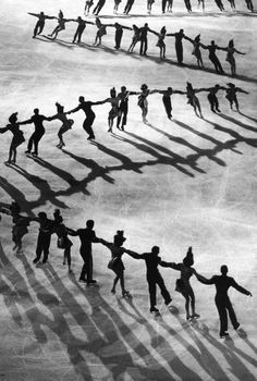 Photo by Gjon Mili, 1948. Ice skaters gained new territory in 1879, when an artificially frozen rink opened in New York City. The picture above are Skaters of Hollywood Ice Revue at Madison Square Garden.)