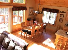 Great room layout adds to spacious feel. Dining table seats 8-10 with additional seating at the kitchen island.