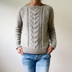 This super basic pullover is all about one simple detail: the wide cable and lace panel falling down the front.  Since it's worked in an aran to chunky weight yarn, the lace looks modern and the sweater knits up in no time! Find this pattern and more knitting inspiration at LoveKnitting.Com.