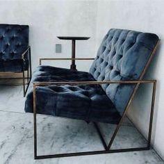Marbled floor, metal frame and tufted blue velvet upholstery
