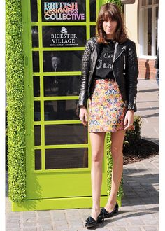 Alexa Chung - The lovely Alexa Chung charms us as she always does with her casually cool fashion forward look. Whatever the style secret is, Alexa is always in on it. A little bit tomboy on top, wearing a quilted moto jacket and classic tee, she goes girly with a floral mini for contrast. And the loafers just kill – don't they?