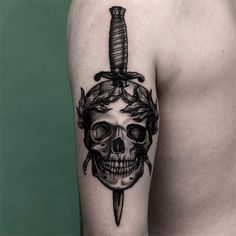 dagger and skull on backside of the upper arm from yesterday