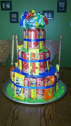 """Birthday """"cake"""" using pop cans, candy bars, and beef jerky sticks. (dad presents candy bars) Candy Birthday Cakes, Birthday Cake For Him, Candy Cakes, Birthday Ideas, Birthday Basket, Birthday Nails, Birthday Crafts, 13th Birthday, Birthday Presents"""