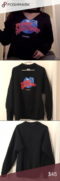 Planet Hollywood Choker Cut Out Sweater Planet Holly Wood long sleeve crewneck sweatshirt. Very comfy with a soft and warm inside. Great staple for a vintage look!   Fits size XS-M as an oversized shirt or fits regular for a size large.   Handmade ✨  Fits size: XS-L  Before shipment, ALL items in my closet will be cleaned.   !!!! BUNDLE AND SAVE !!!!  Brands in my closet include: H&M, Forever 21, Victoria's secret pink, Nike, Urban Outfitters, Pacsun, LF, Brandy Melville, topshop, Free…