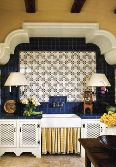 Darling potting area with lamps, blue tile, checked farm sink skirt with pom pom trim - interior design by Jackye Lanham & Associates, architecture by Yong Pak - Norman Askins Architects