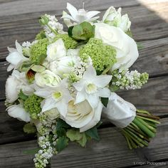 lilac, helebore, white lilies, ranunculus, tulips and polo roses