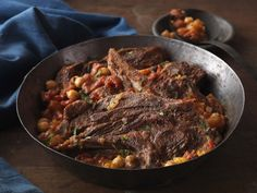 Find out how to make Moroccan Lamb Chops with Chickpea-Tomato Tagine