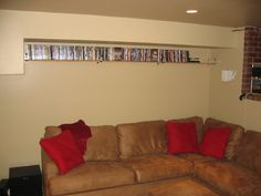 Up high DVD storage shelves. Out of the way
