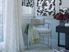 Chic and Sleek    Designer Erinn Valencich spices up solid white walls with black-and-white floral Roman shades.