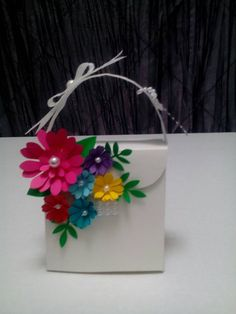 This attractive purse is 4 L, 3 W and 6 H, it fit about chocolate s truffles in it. Personal tag is included. The color of the flower can be change but the purse can only be white or black Paper Bag Crafts, Paper Gifts, Felt Crafts, Creative Gift Wrapping, Creative Gifts, Homemade Gifts, Diy Gifts, Paper Bag Design, Decorated Gift Bags