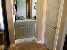 DIY Baby Gate, clever. I need a similar version for my craft room..