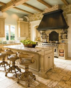 I really love this kitchen, from the stove hood, to the stone floor, to the rustic beams! Wow.