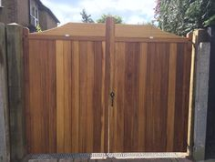 Hardwood estate gates in the Abbeywood design. Made from the finest, hand selected Iroko timber that offers a natural blend of deep tones. Wood Gates, Driveway Gate, Western Red Cedar, Entrance Gates, Fences, Hardwood, Construction, Deep, Doors