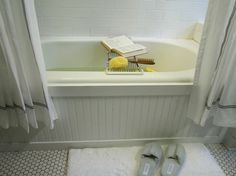Beadboard Bathtub Surround Beadboard is handy for covering dishwashers, ceilings, and other surfaces that lack style. This standard-issue bathtub got an elegant upgrade with a custom beadboard tub surround. Bad Inspiration, Bathroom Inspiration, Bathroom Ideas, Bathroom Designs, Furniture Inspiration, Bathroom Storage, Modern Bathroom, Tan Bathroom, Easy Bathroom Updates