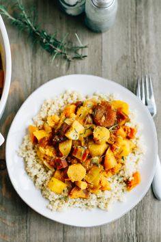 A slow simmered root vegetable tagine with apricots and rosemary! Serve this vegetarian dish as a side or over rice or quinoa for a complete meal.