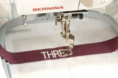 After sewing up a project, whether it's for a gift or myself, I like to add an extra-special touch with a personalized ribbon label stitched with an embroidery machine.